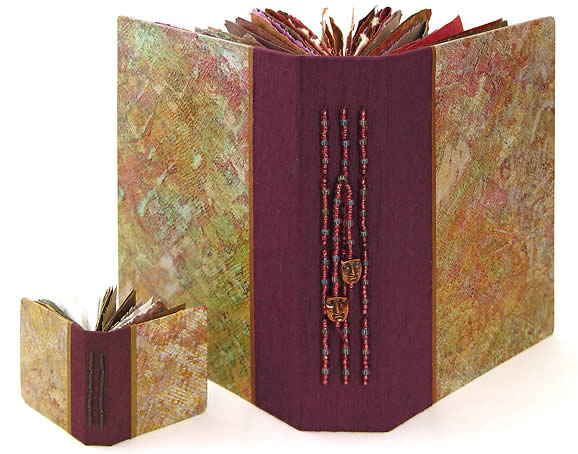 Book of Plenty and Mini Prayer Book, hand made books featuring painted decorative papers, large picture, by Robin Atkins, bead artist