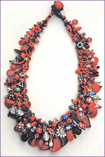 Mostly Red, a woven treasure necklace featuring red trade beads by Robin Atkins, bead artist